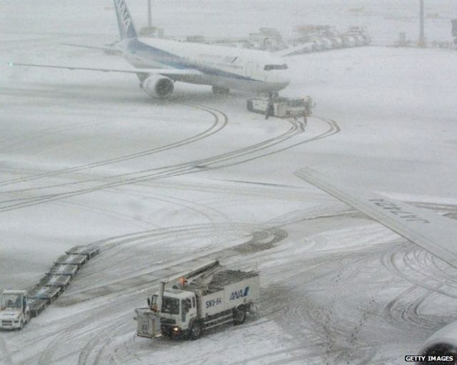 Japan snowfall disrupts air, rail and road transport