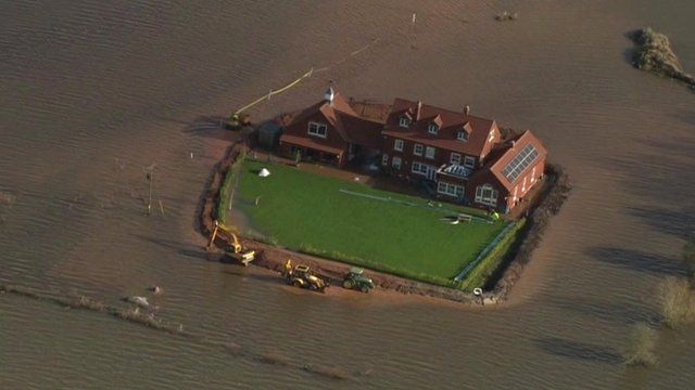 House surrounded by floodwater in the Somerset Levels