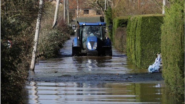 A tractor drives in flood water at Burrowbridge on the Somerset Levels on February 9, 2014