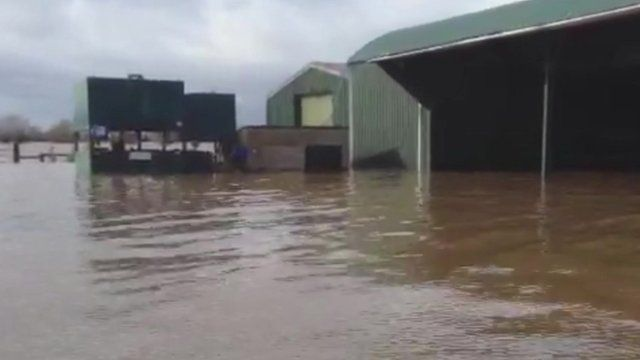 Outbuildings at Moorlands Farm, Somerset, inundated with floodwater