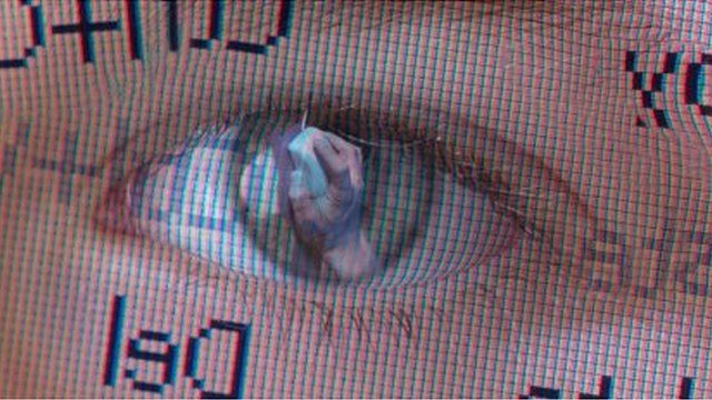 Child's eye reflected on computer screen