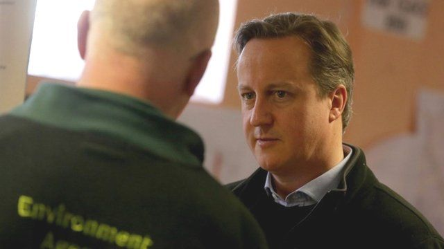 David Cameron meets Environment Agency representatives at the multi-agency run Silver Command control room at Taunton Command Centre