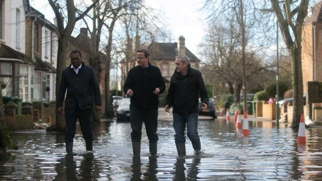 David Cameron walks through flood water during a visit to Staines-upon-Thames