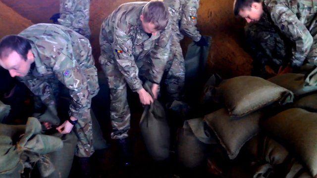 Soldiers from the 10 Training Battalion, Bordon Garrison, filling sandbags in Wraysbury