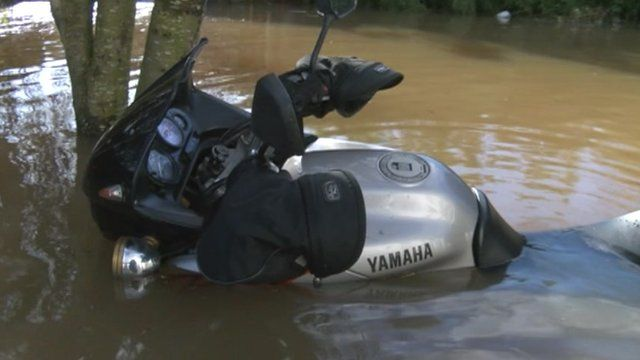A motorcycle surrounded by floodwater in East Lyng, Somerset