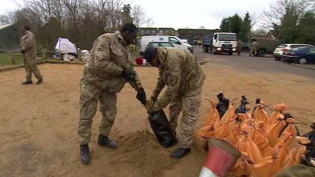 Soldiers filling sandbags