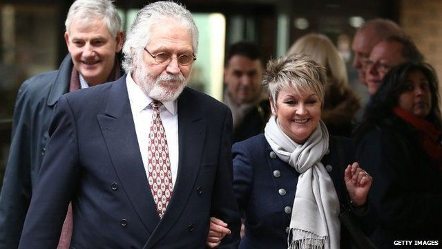Dave Lee Travis leaves Southwark Crown Court with his wife Marianne Griffin