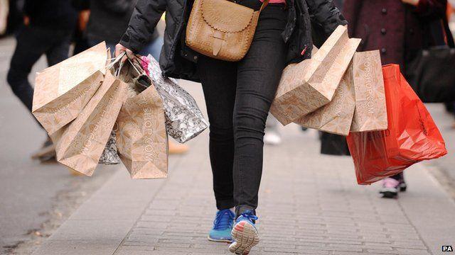 A shopper carrying shopping bags