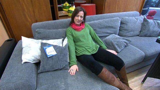Sarah Falkland on the donated sofa