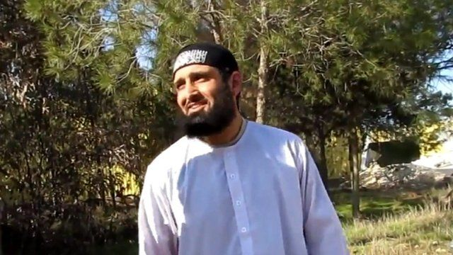 Still from video appearing to show Abdul Waheed Majid