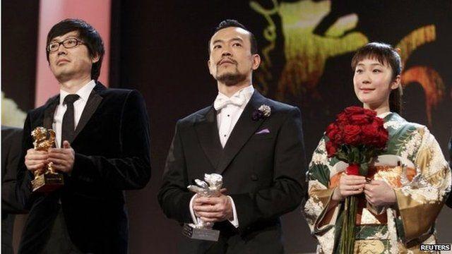 Diao Yinan (left), director of Bai Ri Yan Huo, poses with his Golden Bear for Best Film next to actor Liao Fan, with his Silver Bear for Best Actor, and actress Haru Kuroki, with her Silver Bear for Best Actress