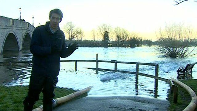 Nick Beake stood by an overflowing Thames in Chertsey
