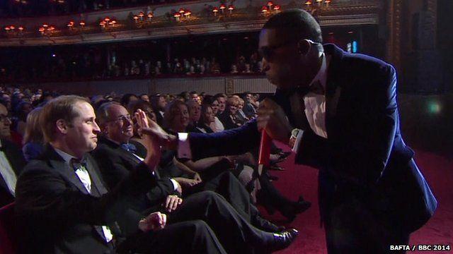 Tinie Tempah high-fives Prince William
