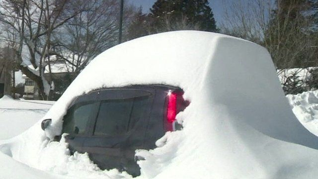 A snow covered car in Japan