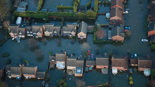 Aerial view of flooded houses in the Thames Valley