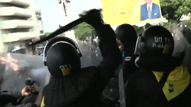 Riot police confronting protesters in Bangkok