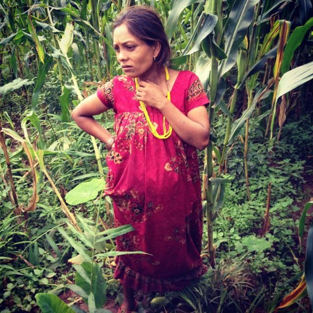 Seven months pregnant and working in the fields