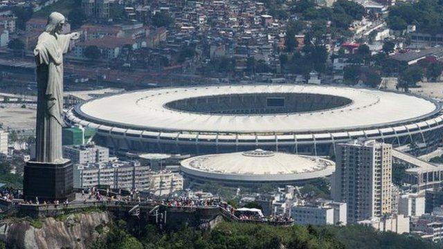 Aerial view of the Christ the Redeemer statue atop Corcovado Hill and the Mario Filho (Maracana) stadium in Rio de Janeiro, Brazil
