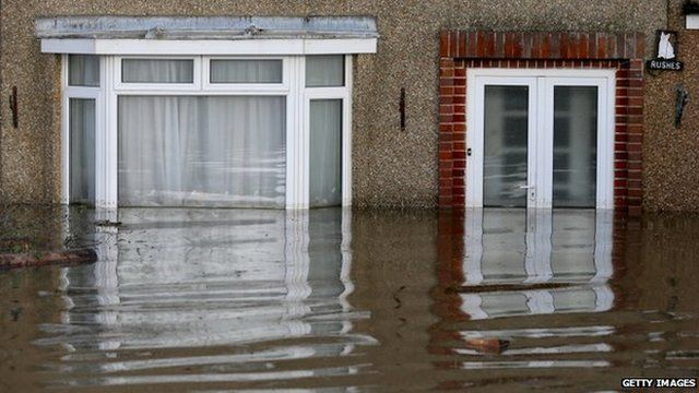 Flood water continues to surround properties in the largely evacuated village of Moorland on the Somerset Levels