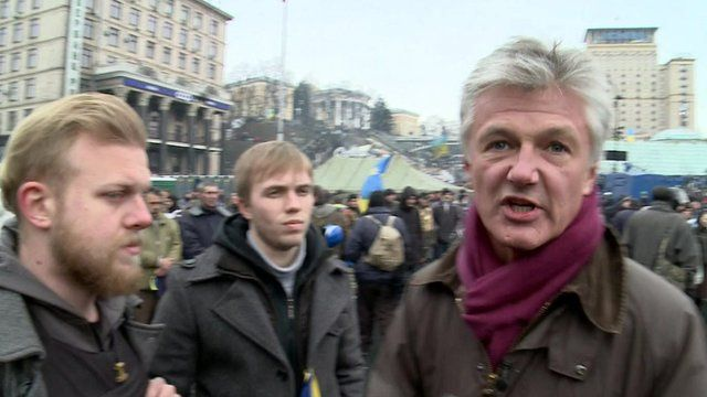 Tim Willcox with opposition protesters
