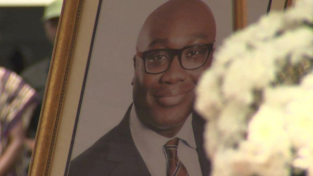A photograph of Komla Dumor and flowers