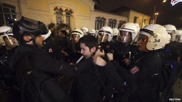 Riot police detain a demonstrator during a protest against internet censorship in Istanbul