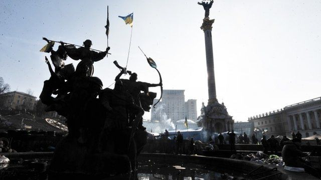 Smoke billows from stoves used by anti-government protesters camp at central Kiev Independence square