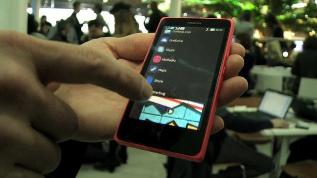 BBC Technology Correspondent Mark Gregory is shown the new Nokia X range of smartphones at the Mobile World Congress in Barcelona.
