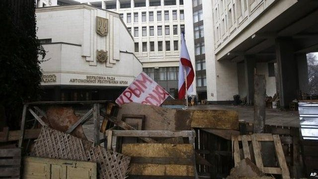 "Barricade in front of regional parliament with sign ""Crimea is Russia"""