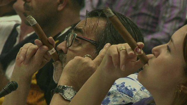 People smoking cigars