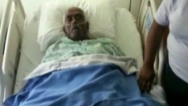 Walter Williams in hospital bed