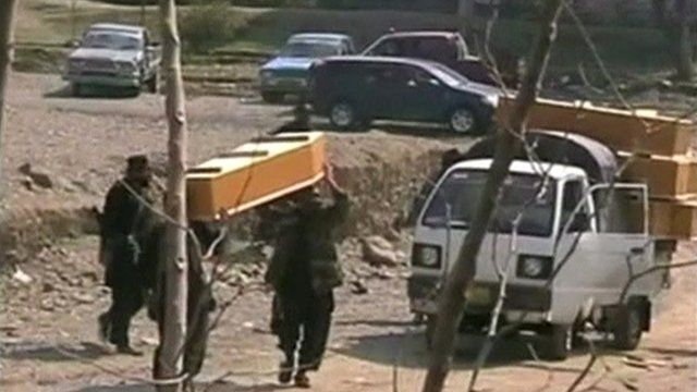 Coffins carried from scene of the bomb