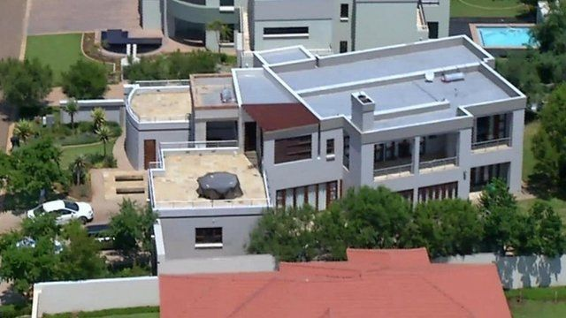 This file aerial image taken from video shows the home of Olympic athlete Oscar Pistorius in a gated housing complex in Pretoria, South Africa