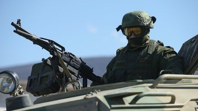Unidentified soldier on an armoured vehicle in Crimea