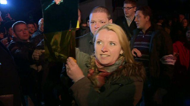 Woman in Sevastopol holding up Ukrainian colours