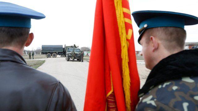 Ukrainian troops watch Russian soldiers carefully