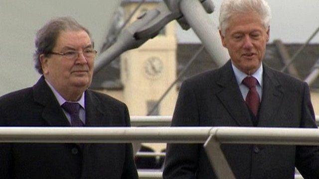 John Hume accompanied Bill Clinton on a walk across the Peace Bridge