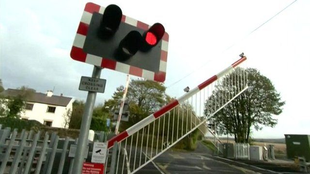 Railway crossing red light and barrier