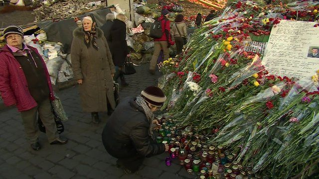 Women leaving flowers and candles