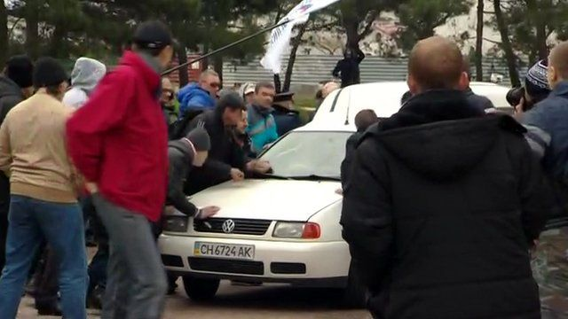 Pro-Russian crowds attack a car with Ukrainian activists in Sevastopol