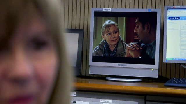 TV showing Eastenders inside the National Grid control room
