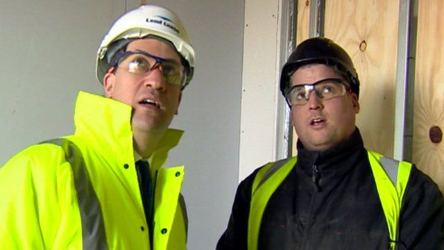 Labour leader Ed Miliband (left) tours a building site