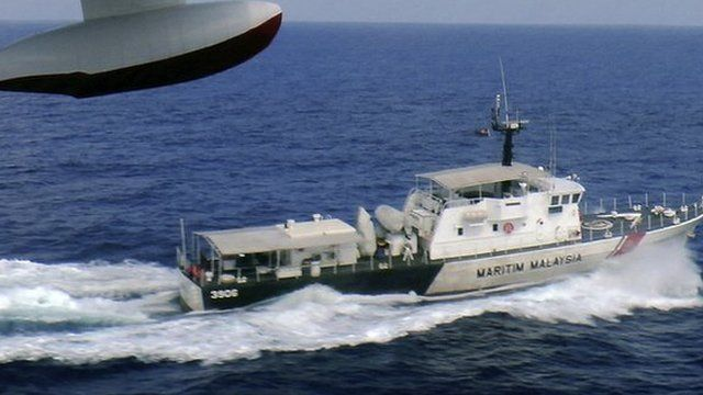 A patrol vessel of Malaysian Maritime Enforcement Agency searches for the missing Malaysia Airlines plane