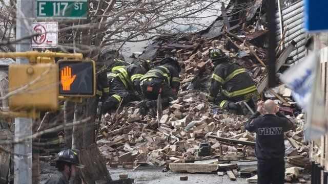 Firefighters dig through rubble