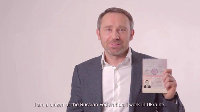Man holding up Russian passport in YouTube video