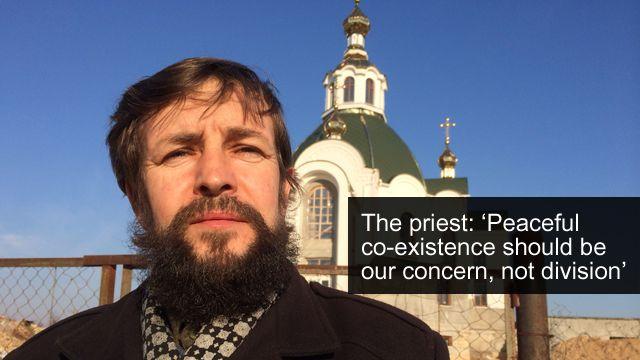 Priest outside church