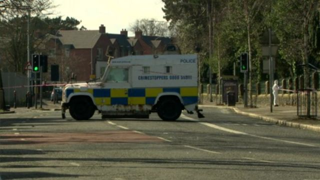 Belfast police targeted in Falls Road bomb attack