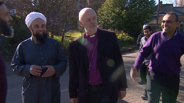 Members of the Indian Muslim Welfare Society in Somerset meeting a local vicar