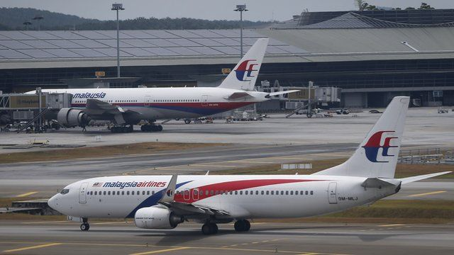 A Malaysia Airline Boeing 737-800 plane taxis by main terminal at Kuala Lumpur International Airport in Sepang.