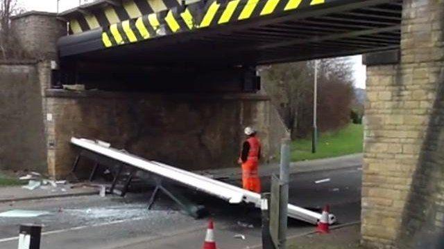 Damage to bridge after bus drove under it